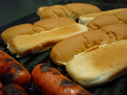 dogs and buns on grill