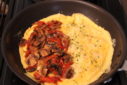 ... sauteed pepper, onion and mushroom mixture onto half of the eggs