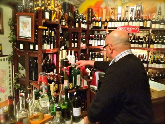 Dimitri Demjanov selects wine at Gloria Wine Cellar