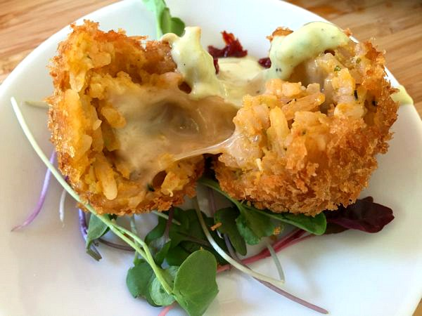 California Avocado and Hemp Seed Arancini with Sun Dried Tomato Avocado Ranch on Organic Microgreens